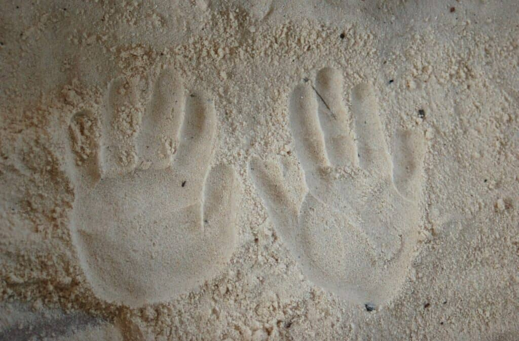 handprints in the sand