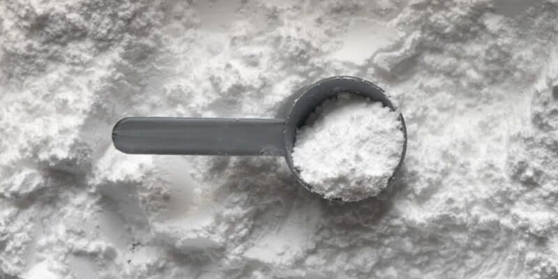 measuring cup of white powder