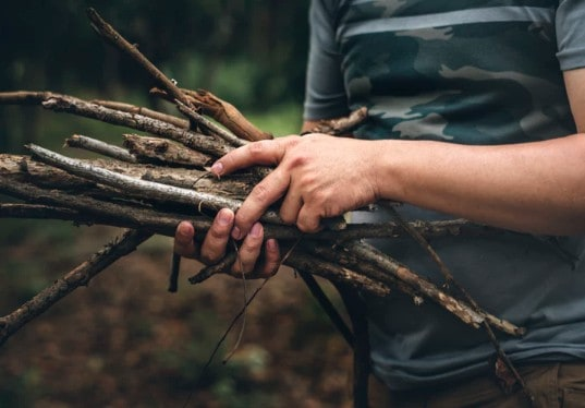 boys hands holding sticks