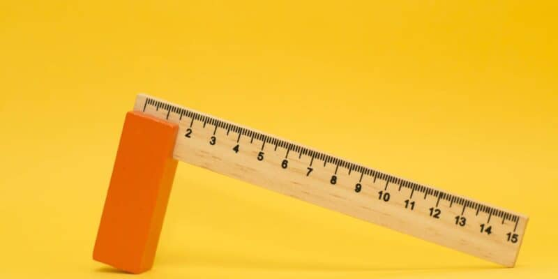 wood ruler with yellow background