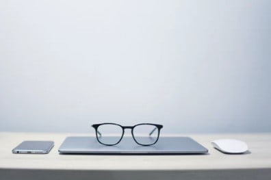 glasses laying on laptop