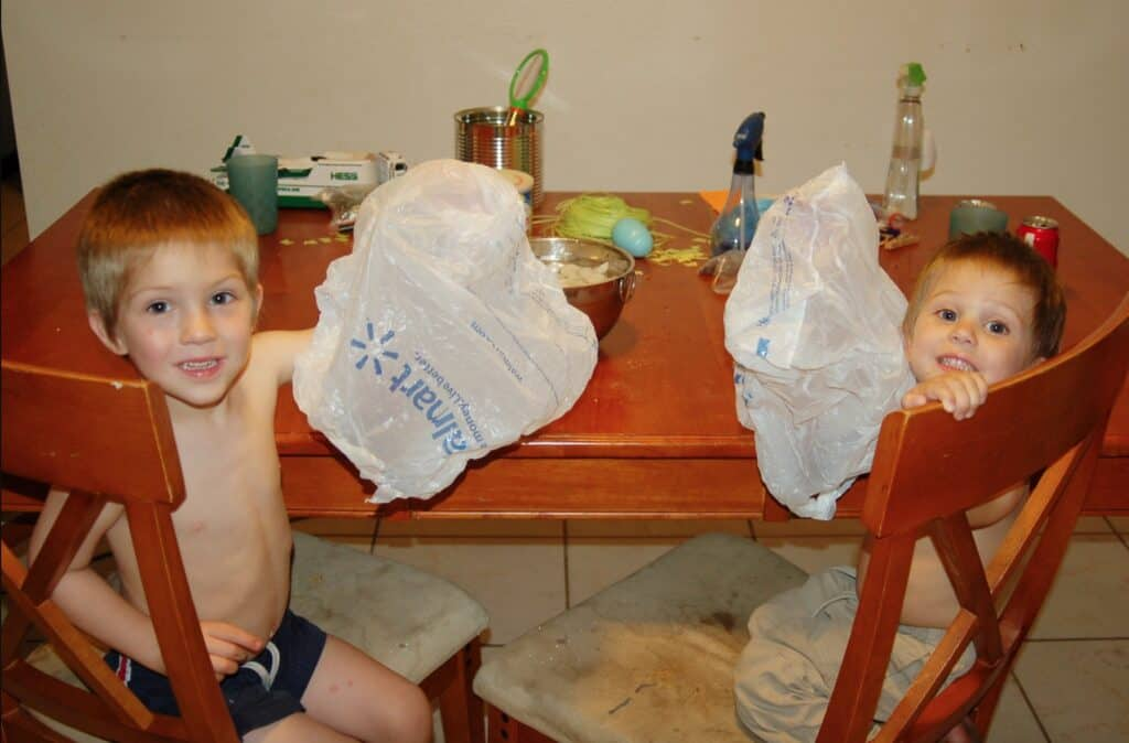 boys doing ice science experiment