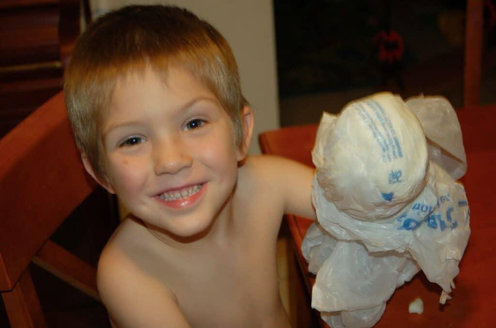 boy doing blubber science experiment