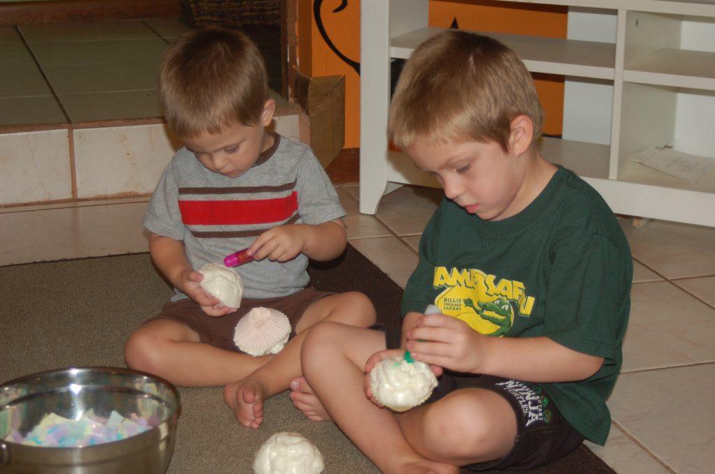boys decorating cupcake craft with foam insulation