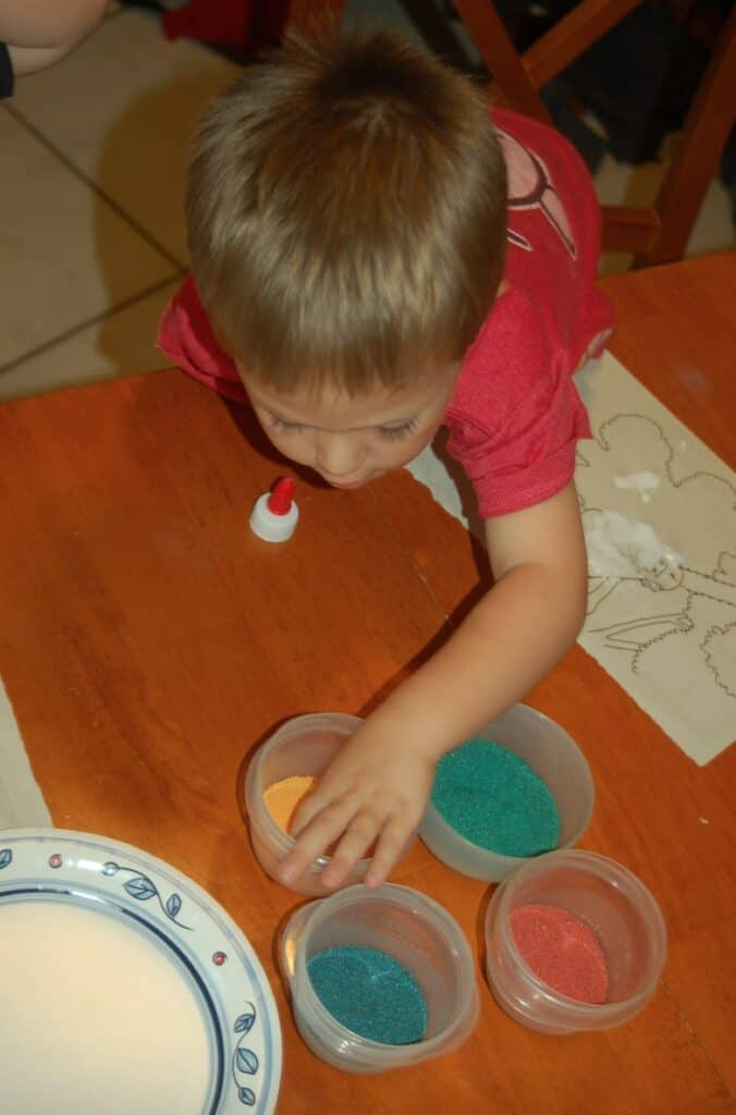 boy crafting with art sand