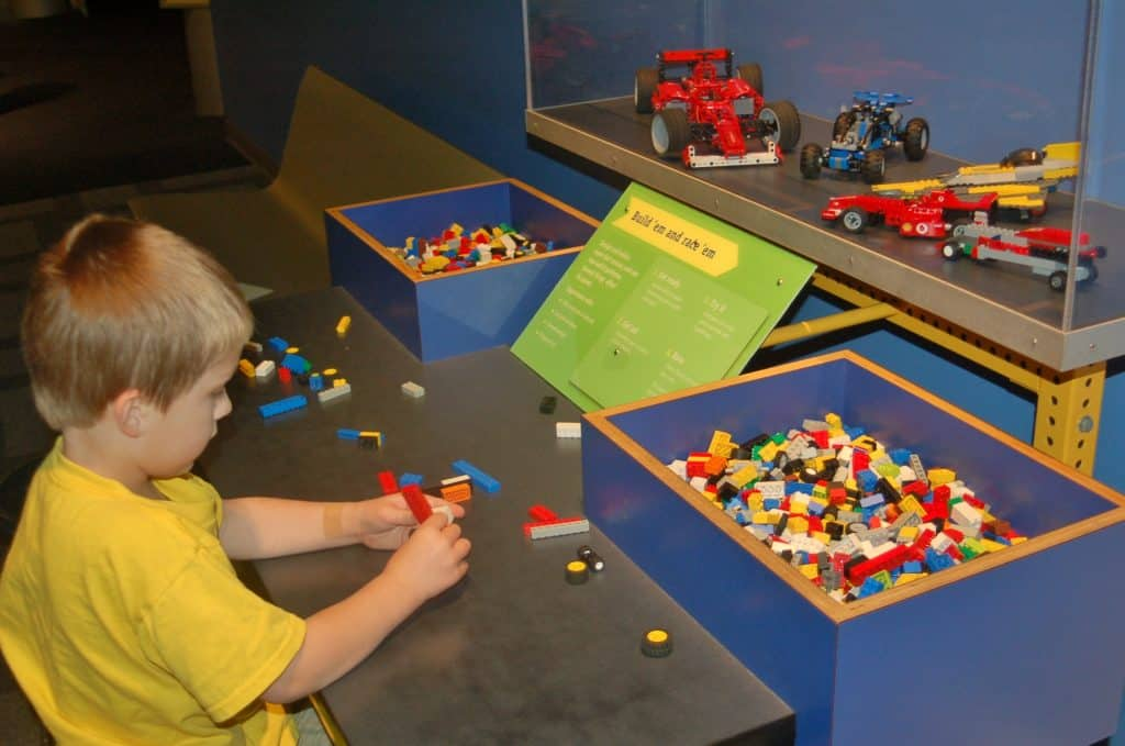 building LEGO cars at the Des Moines Science Center of Iowa