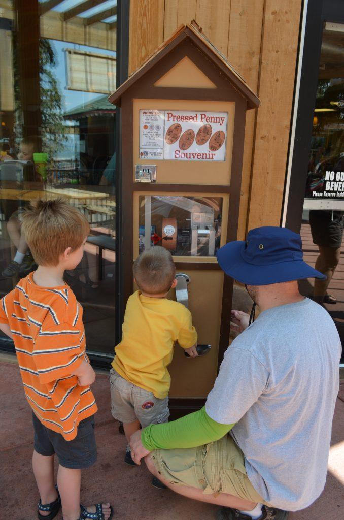 boys using pressed penny machine