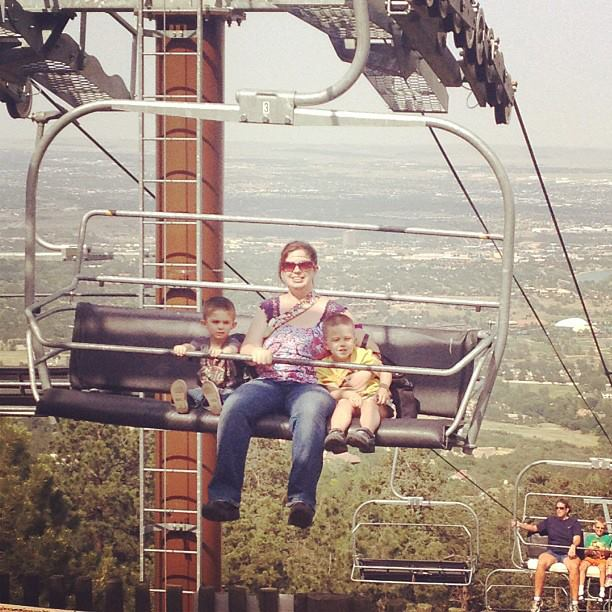 mom with two boys sitting on ski lift