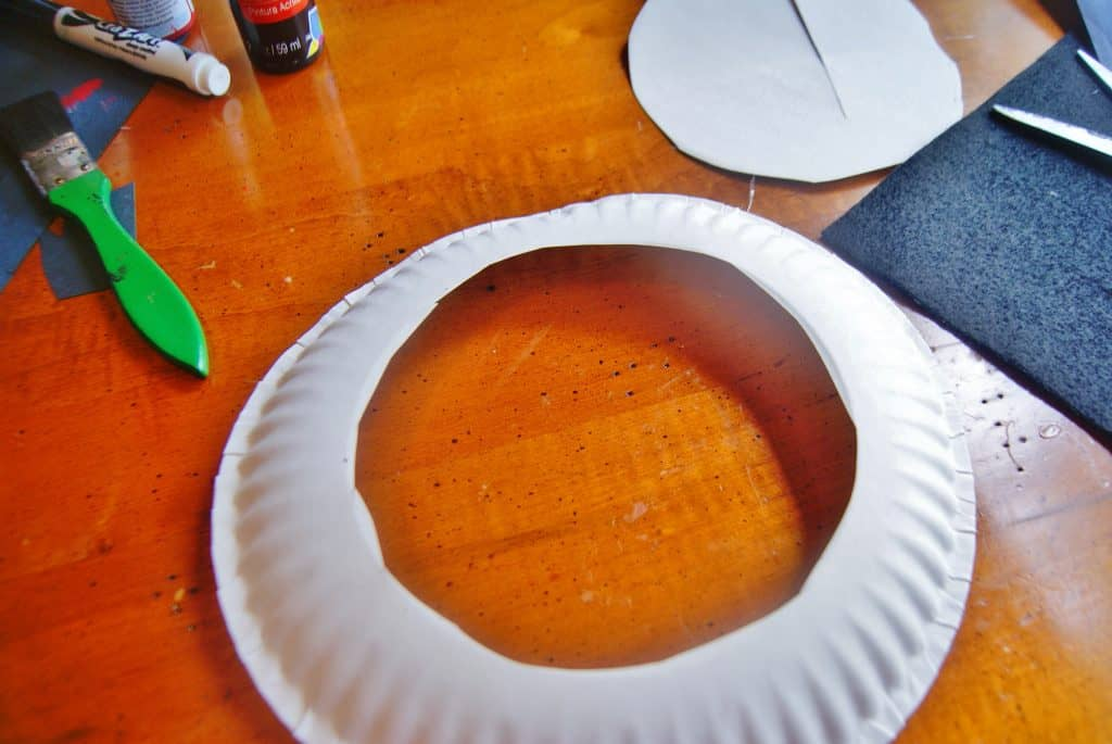 white paper plate with circle cut in middle