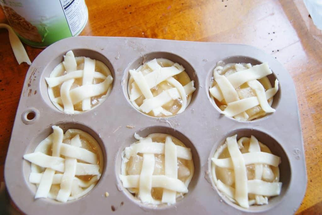 mini apple pies in metal baking tin