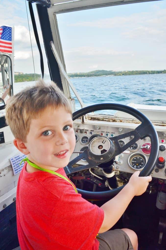 boy driving amphibious Ducks in Branson