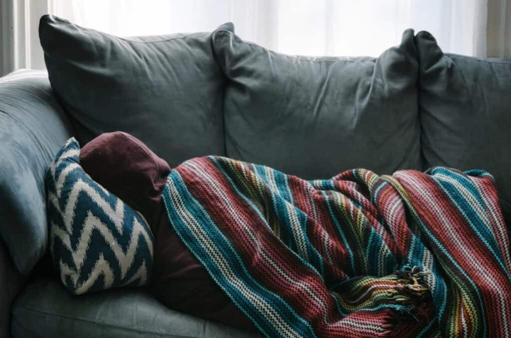 teen sleeping on couch