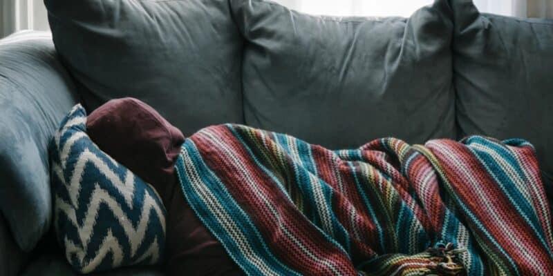 teen sleeping on couch
