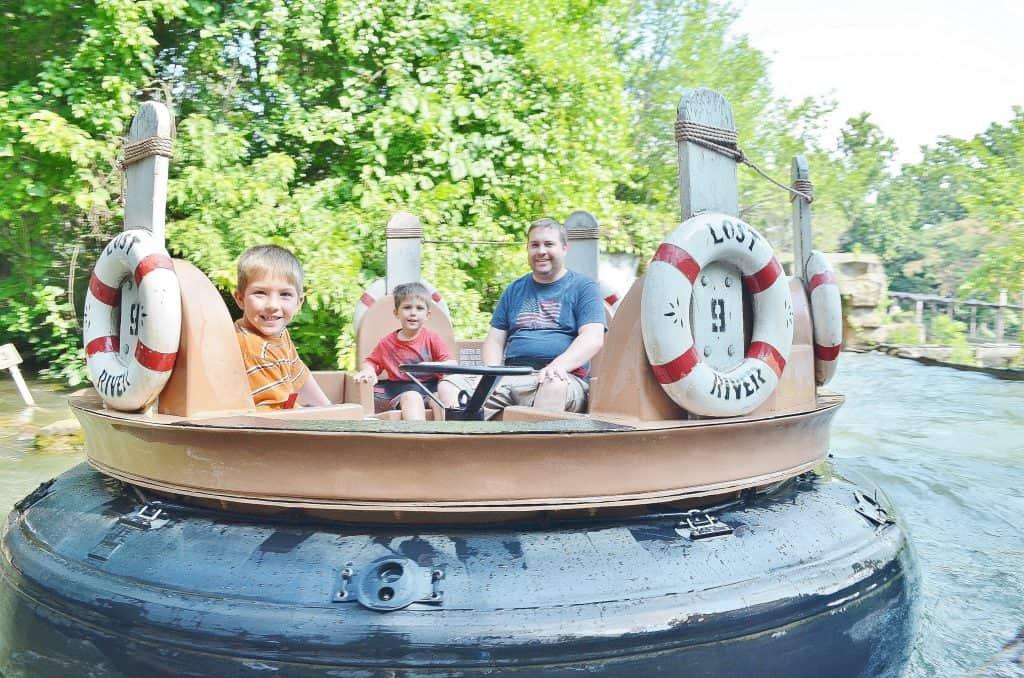 family riding river rapids branson
