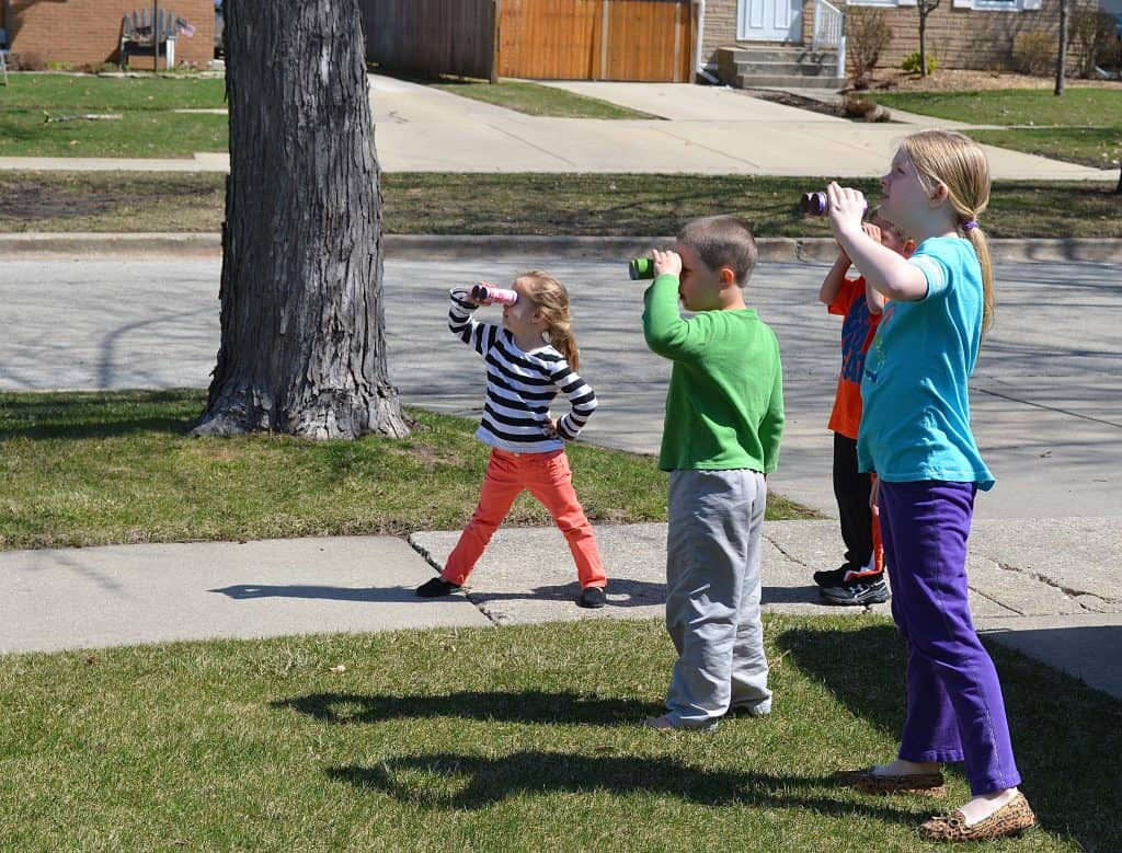 kids looking through binoculars going on a bear hunt