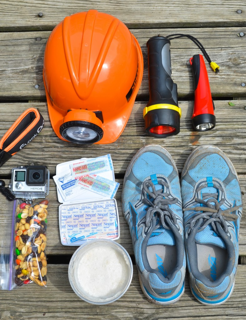 adventure packing shoes, flashlight and first aid