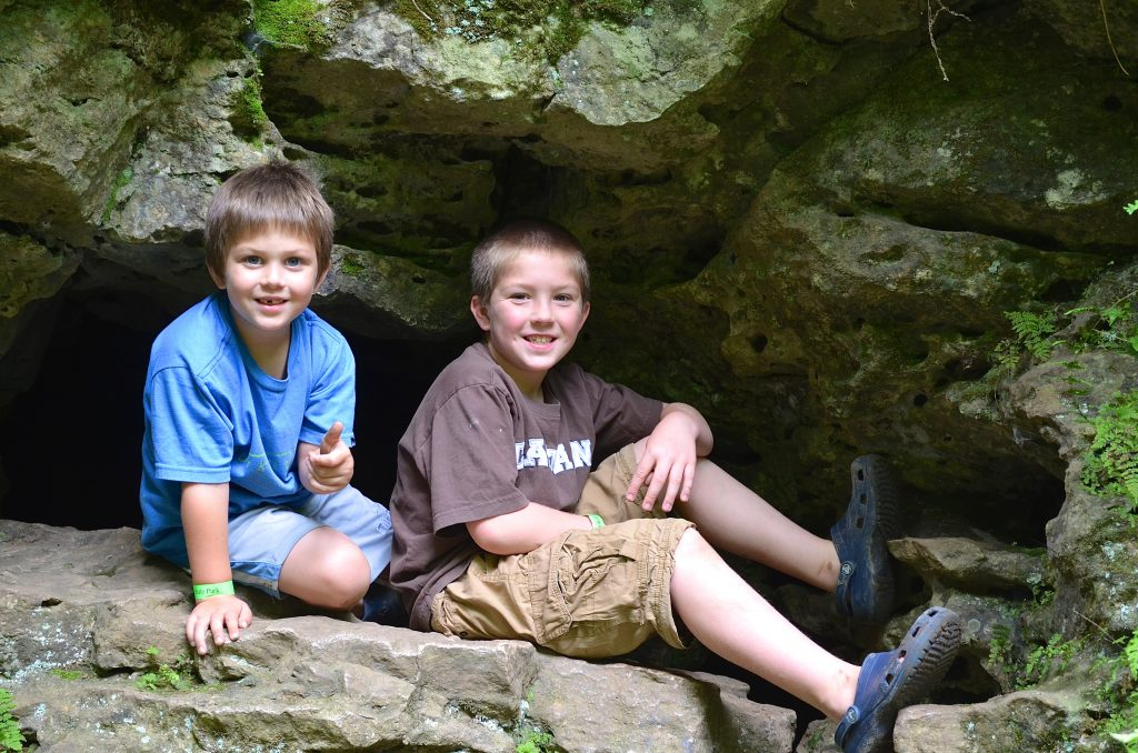 boys inside a cave in Maquoketa State Park