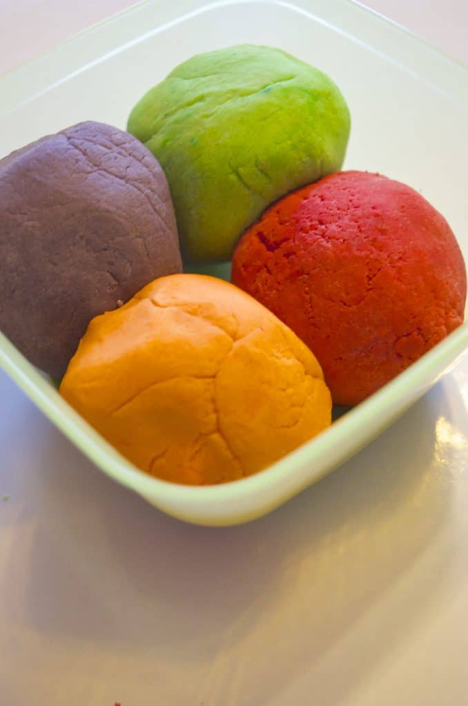 bowl of four colors of homemade play dough