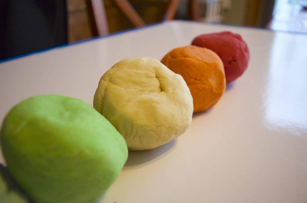 four balls of homemade play dough