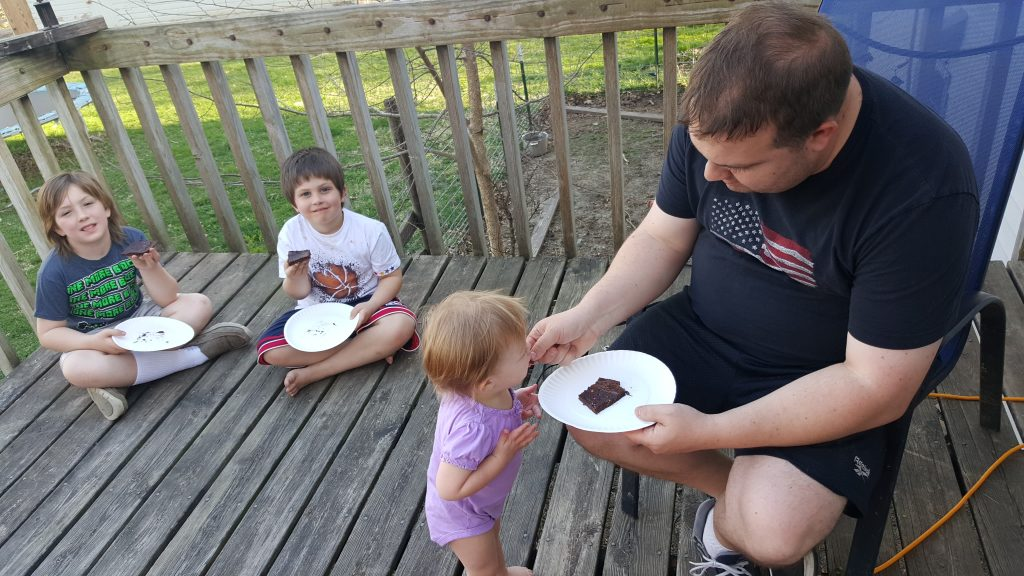 Brownies over the Campfire: Making Family Memories - Just cut a half of a Pillsbury Brownie Mix box in half, mix in your cast iron pan, and bake over the campfire!