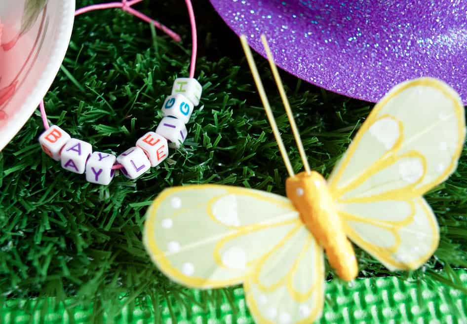 up close view of magical tea party butterfly and bracelet
