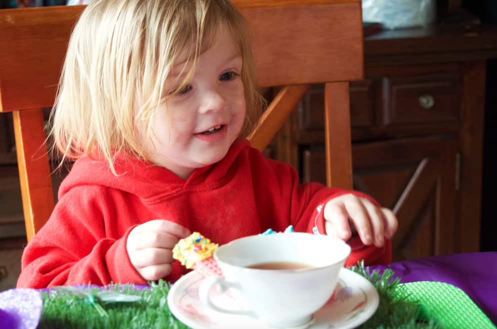 little girl at pretend play tea party