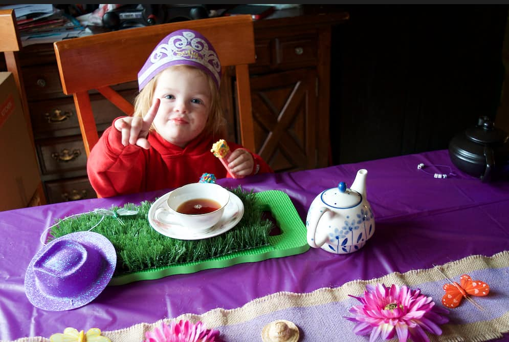little girl at a magical tea party
