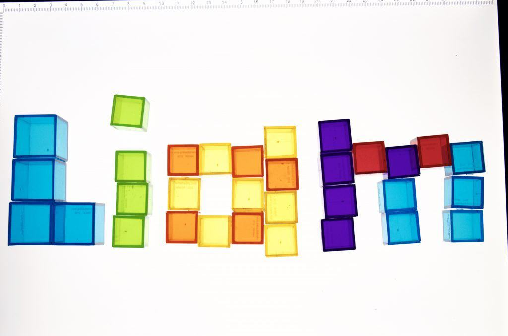 Light Table Spelling Letters with Transparent Cube Counters