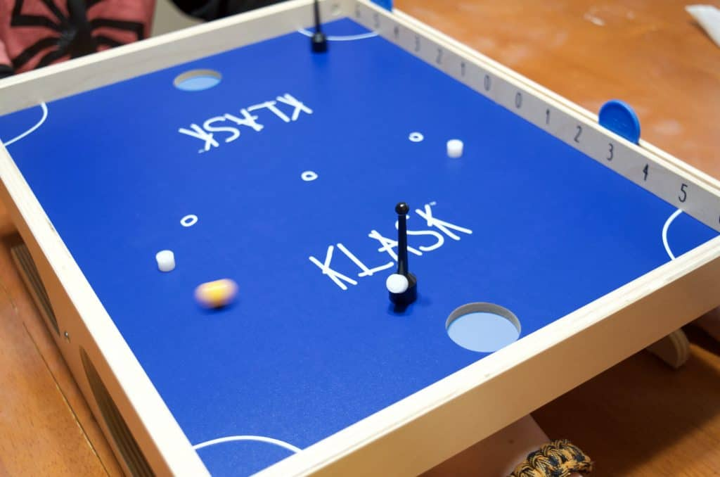 Klask Game board with game pieces