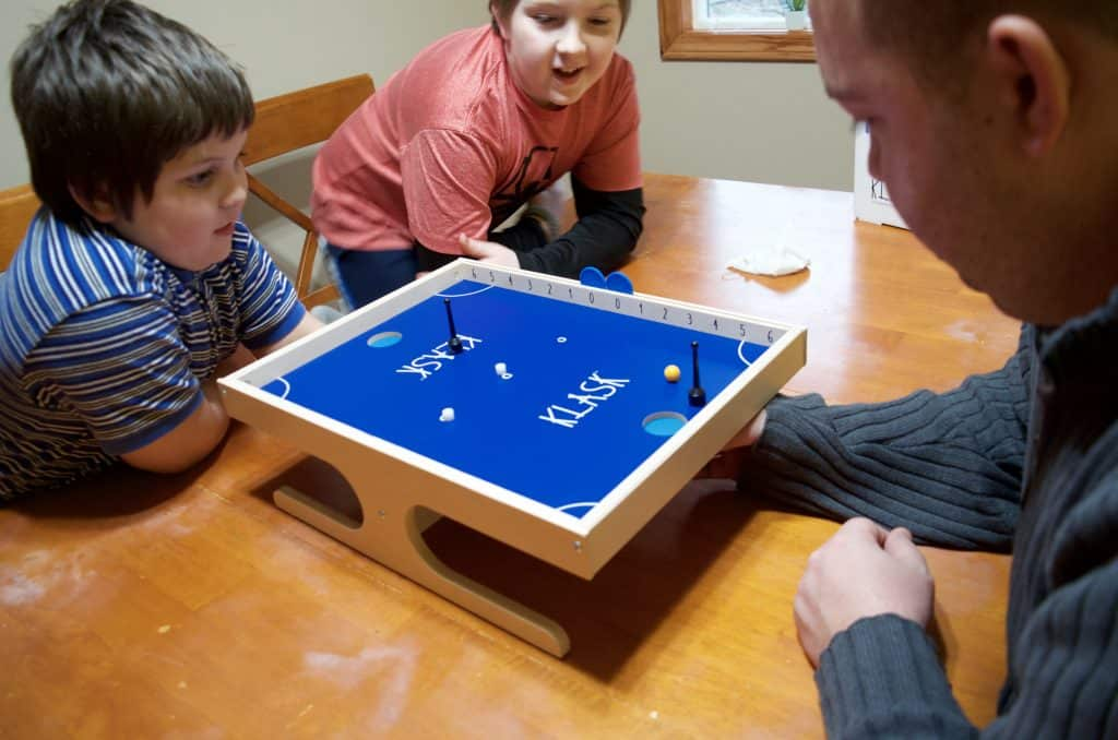 family playing Klask for family game night