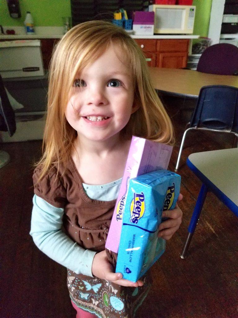 little girl holding PEEPS Easter Candy