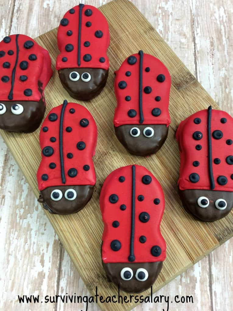 ladybug cookies on wood cutting board