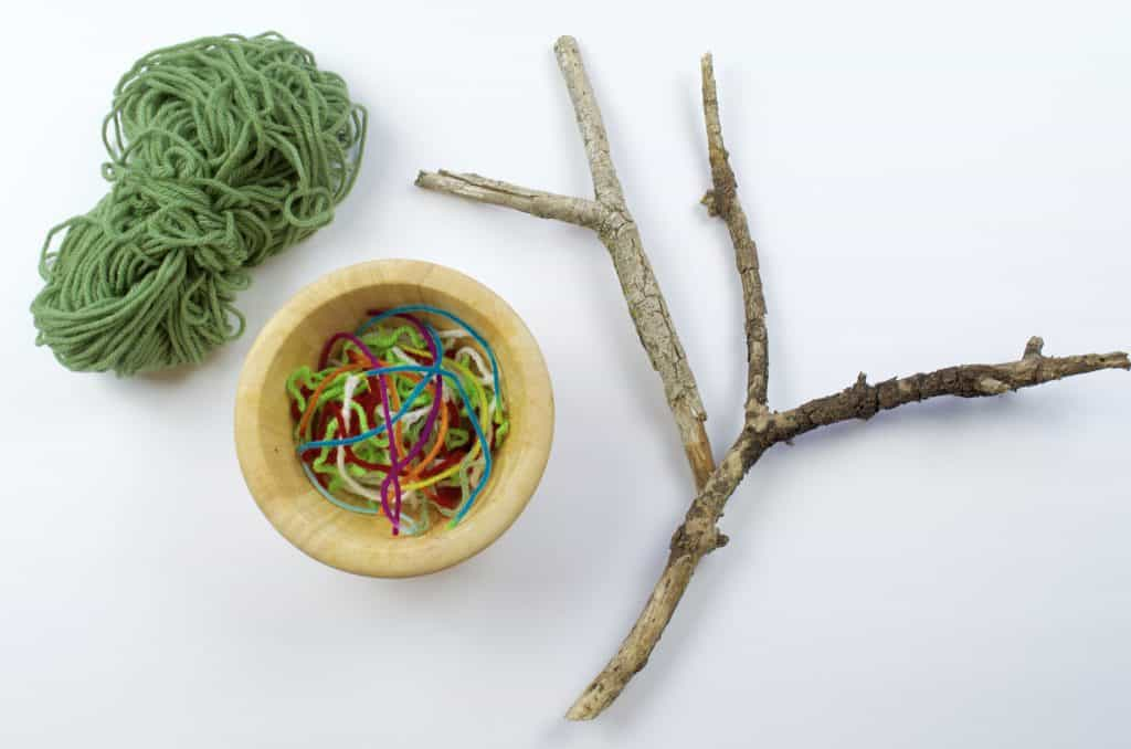 camping craft stick and yarn activity