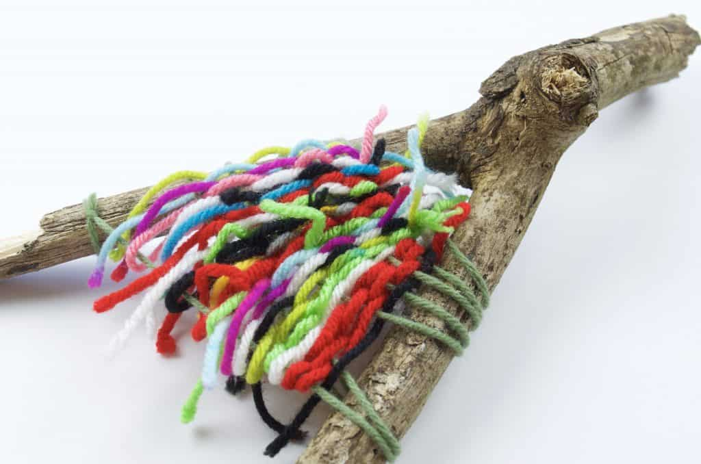 stick with colors of yarn wrapped camping craft