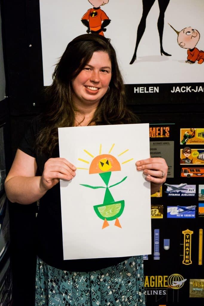 woman holding superhero craft