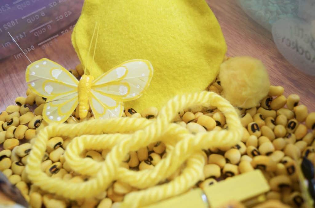 yellow color sensory bin