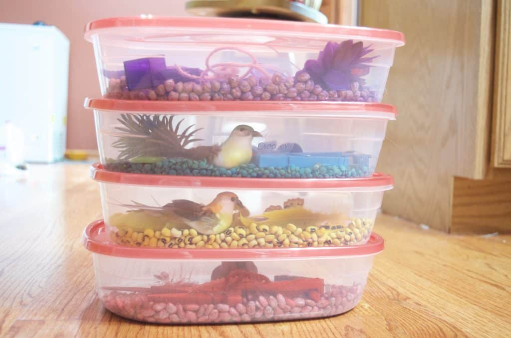 stack of colored sensory bins