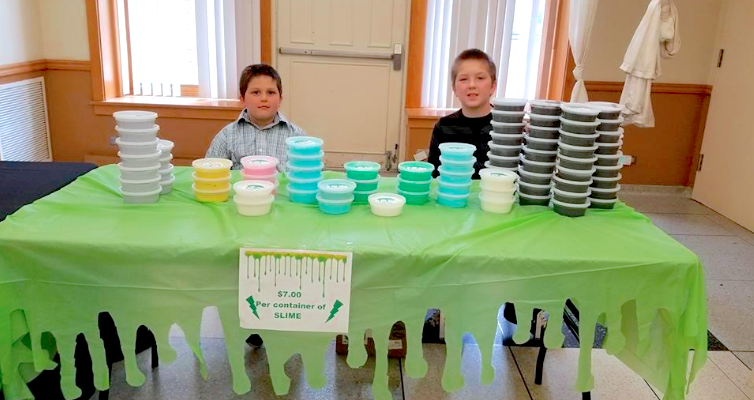 two boys kid entrepreneur selling slime