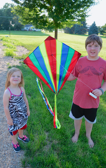 boy and girl with kite