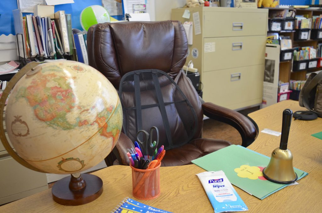 teacher desk in classroom with PURELL Hand Wipes