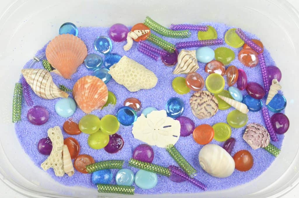 mermaid sensory bin with seashells