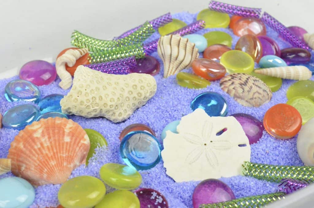 close up of mermaid sensory bin for preschool play