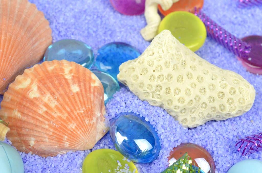 Mermaid Sensory Bin with seashells to play
