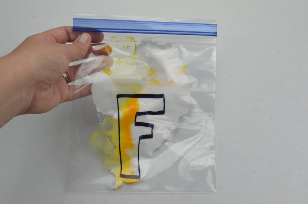 letter F with shaving cream in bag sensory play