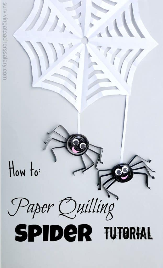 two paper quilled spiders on web