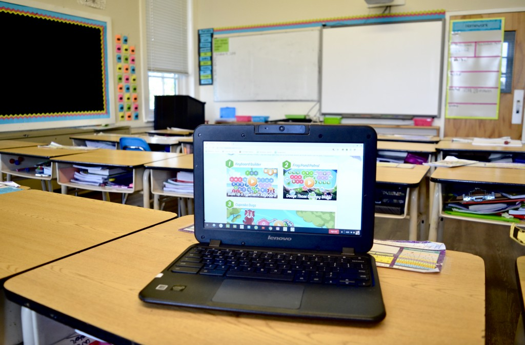 computer typing program on school desk in classroom