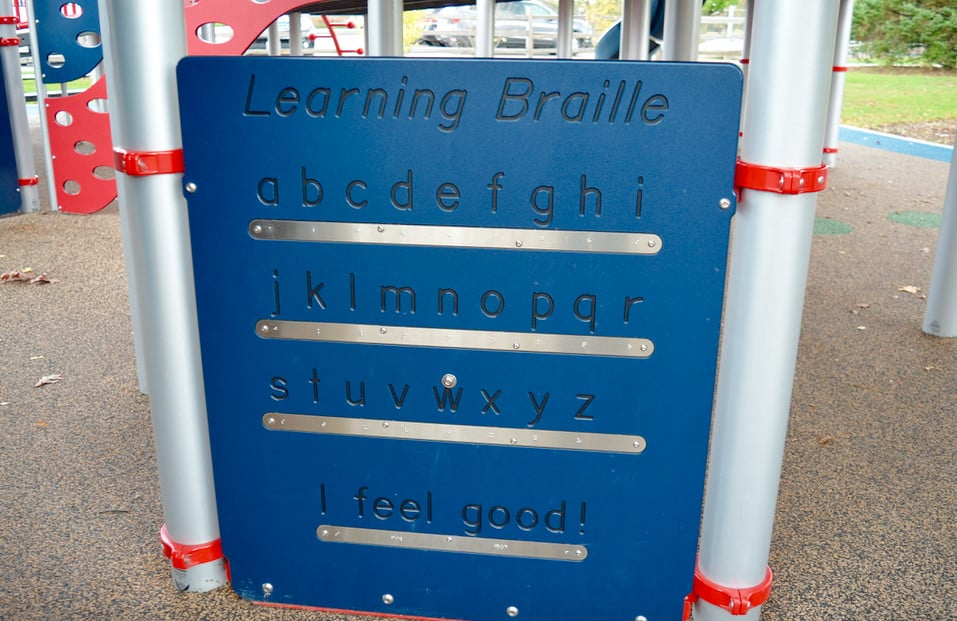 Learning Braille sign on playground