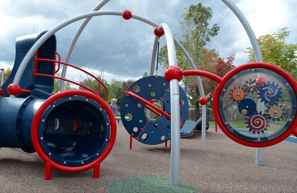 blue and red inclusive playground equipment