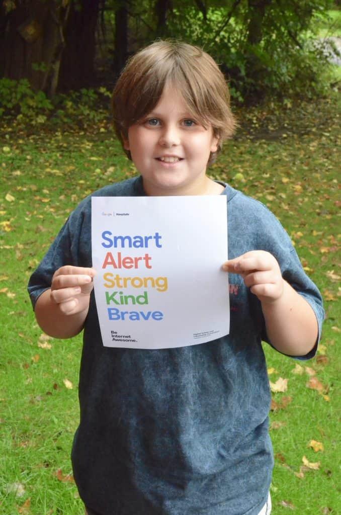boy holding kindness Google Be Internet Safe poster