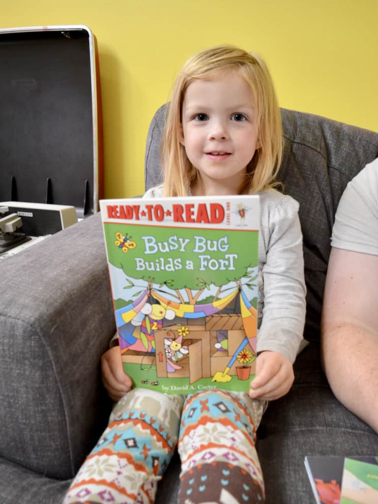 girl with Ready to Read level book